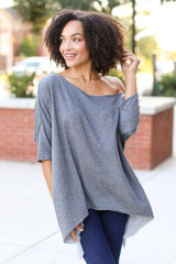 Charcoal - Model wearing a Soft Knit Oversized Top with dark wash jeans