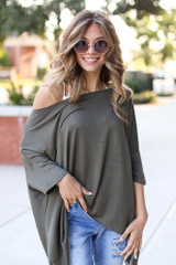 Olive - Model wearing a Soft Knit Oversized Top with distressed skinny jeans