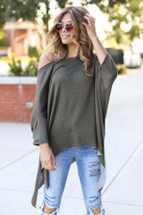Olive - Dress Up model wearing a Soft Knit Oversized Top with distressed skinny jeans
