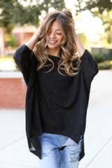Black - Dress Up model wearing a Soft Knit Oversized Top with light wash jeans