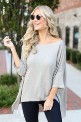 Taupe - Model wearing a Soft Knit Oversized Top with black leggings