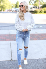 Dress Up model wearing a Cropped Hoodie with distressed mom jeans