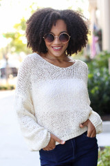 Ivory - Dress Up model wearing an Oversized Loose Knit Sweater with dark wash jeans
