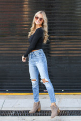 Dress Up model wearing Distressed Mom Jeans with a black crop top