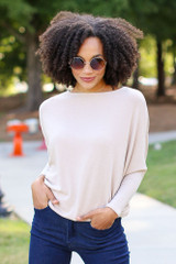 Taupe - Model wearing an Oversized Knit Top with flare jeans