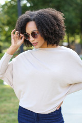 Taupe - Dress Up model wearing an Oversized Knit Top with flare jeans