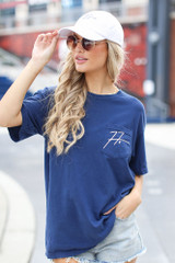 Model wearing the Freddie Autograph Tee