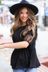 Dress Up model wearing a Puff Sleeve Peplum Top with a wide brim hat