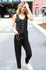 Model wearing a Button Front Jumpsuit with white sneakers
