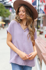Lilac - Model wearing an Oversized Linen Top with a wide brim hat