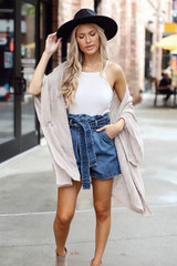 Dress Up model wearing Paperbag Waist Denim Shorts with a white bodysuit