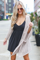 Model wearing a Lightweight Knit Cardigan with a black romper