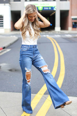 Model wearing Distressed Flare Jeans