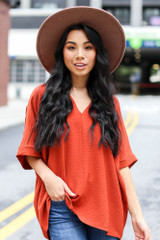 Rust - Model wearing a Textured Oversized Blouse with a wide brim hat