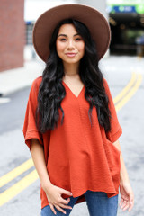 Rust - Dress Up model wearing a Textured Oversized Blouse with a wide brim hat