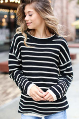 Model wearing an Oversized Striped Sweater
