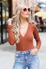 Camel - Model wearing a V-Neck Bodysuit with skinny jeans
