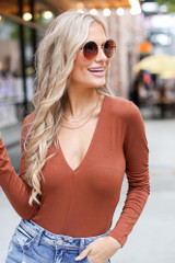 Camel - Dress Up model wearing a V-Neck Bodysuit with skinny jeans