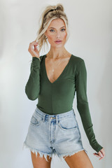 Green - Model wearing a V-Neck Bodysuit