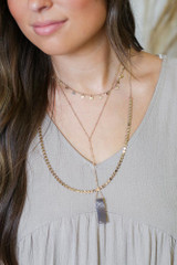 Model wearing a Layered Stone Charm Necklace