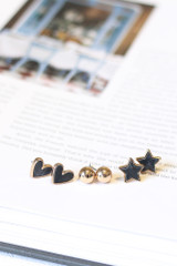 Charcoal - Flat Lay of all 3 earrings in the Star + Heart Stud Earring Set