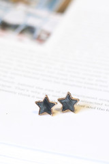 Charcoal - Close Up of the star earrings in the Star + Heart Stud Earring Set