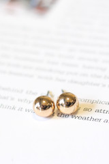 Close Up of the gold ball studs in the white Star + Heart Stud Earring Set