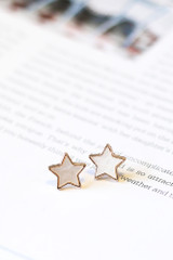 Close Up of the white Star + Heart Stud Earring Set