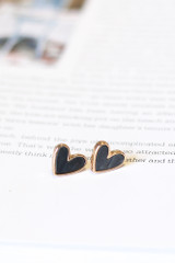 Close Up of the charcoal hearts in the Star + Heart Stud Earring Set
