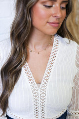 Model wearing a Gold Heart Charm Necklace