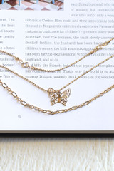 Flat Lay of a Gold Butterfly Layered Necklace
