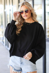 Black - Model wearing an Oversized Fleece Pullover