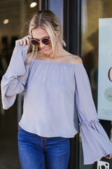 Grey - Dress Up model wearing a Bell Sleeve Off-the-Shoulder Top with flare jeans