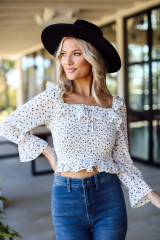 Ivory - Model wearing a Smocked Floral Blouse