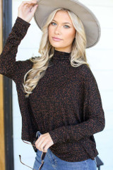 Dress Up model wearing a Leopard Mock Neck Top with a wide brim hat