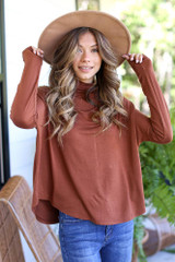 Camel - Model wearing a Mock Neck Top with a wide brim hat