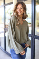 Olive - Dress Up model wearing an Oversized Waffle Knit Top with skinny jeans