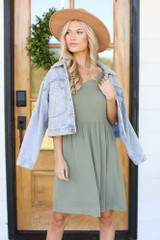Model wearing a Scalloped Dress with a denim jacket