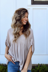Taupe - Dress Up model wearing a Babydoll Blouse with jeans
