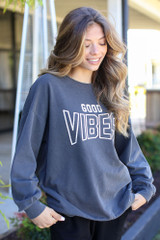 Dress Up model wearing the Good Vibes Pullover with black biker shorts