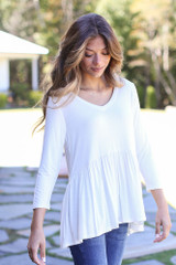 White - Dress Up model wearing an Oversized Babydoll Top with skinny jeans