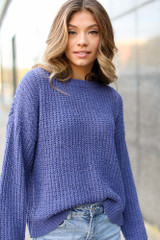 Purple - Model wearing an Oversized Chenille Sweater with skinny jeans