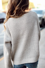 Taupe - Model wearing an Oversized Chenille Sweater with light wash jeans