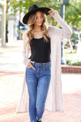Taupe - Model wearing a Loose Knit Cardigan with a black bodysuit