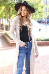 Taupe - Dress Up model wearing a Loose Knit Cardigan with a black bodysuit