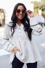 Model wearing a Statement Sleeve Babydoll Blouse