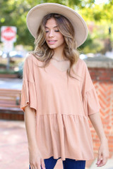 Model wearing an Oversized Babydoll Top with a wide brim hat