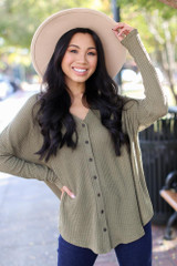 Olive - Model wearing a Button Front Waffle Knit Top with a wide brim hat