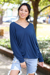 Teal - Model wearing an Oversized Knit Top with distressed boyfriend jeans