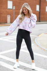 Model wearing a Cropped Tie-Dye Pullover with black leggings